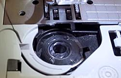 Jam resistant Quick-Set drop-in top bobbin