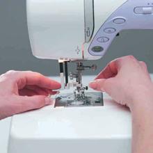 Automatic Needle Threader.