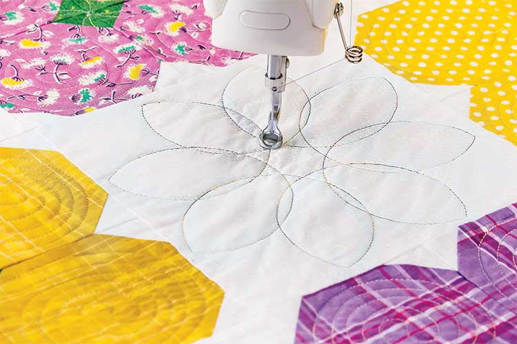 LET YOUR MACHINE DO THE SEWING - Automated quilting in your own home