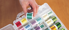 1. Pull all colors needed for embroidery design. Place spools in thread chambers in color order, working left to right on each side.